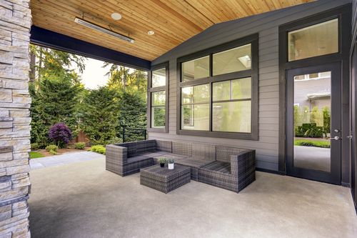New,Modern,Home,Features,A,Backyard,With,Covered,Patio,Accented