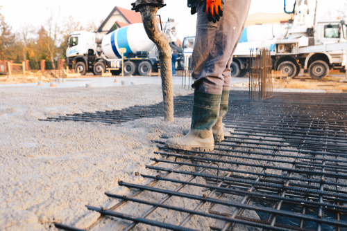 Concrete,Pouring,During,Commercial,Concreting,Floors,Of,Buildings,In,Construction